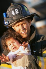 Firefighter Holding Child